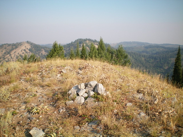 The summit cairn atop Twin Peaks West with [the lower] Twin Peaks East in the background. Livingston Douglas Photo