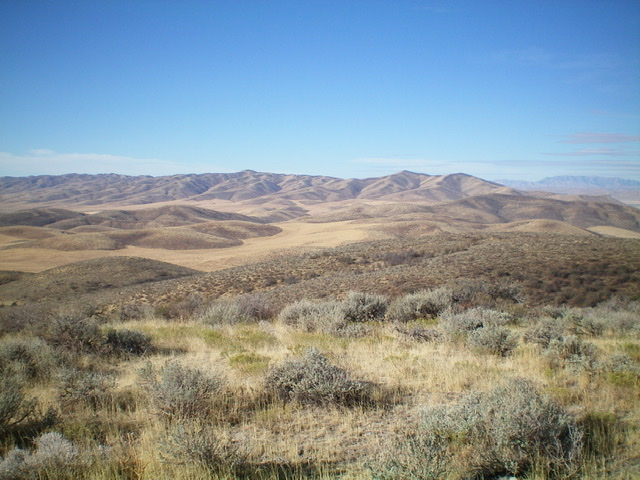 North Hansel Mountain as viewed from the east. Peak 6774 is the pointed hump just right of center. North Hansel Mountains HP is 2 miles to its south (left in the photo) and is the minor hump left of center. Livingston Douglas Photo