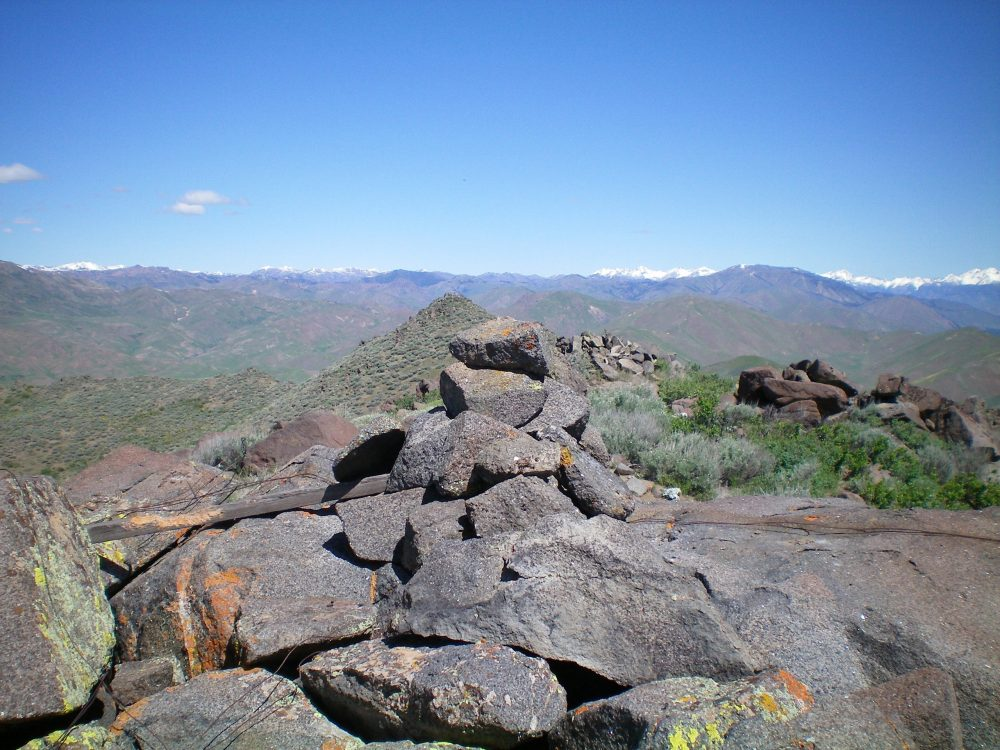 The newly-built summit cairn atop Peak 7158, looking westward. The West Summit is just behind the cairn in the photo. Livingston Douglas Photo