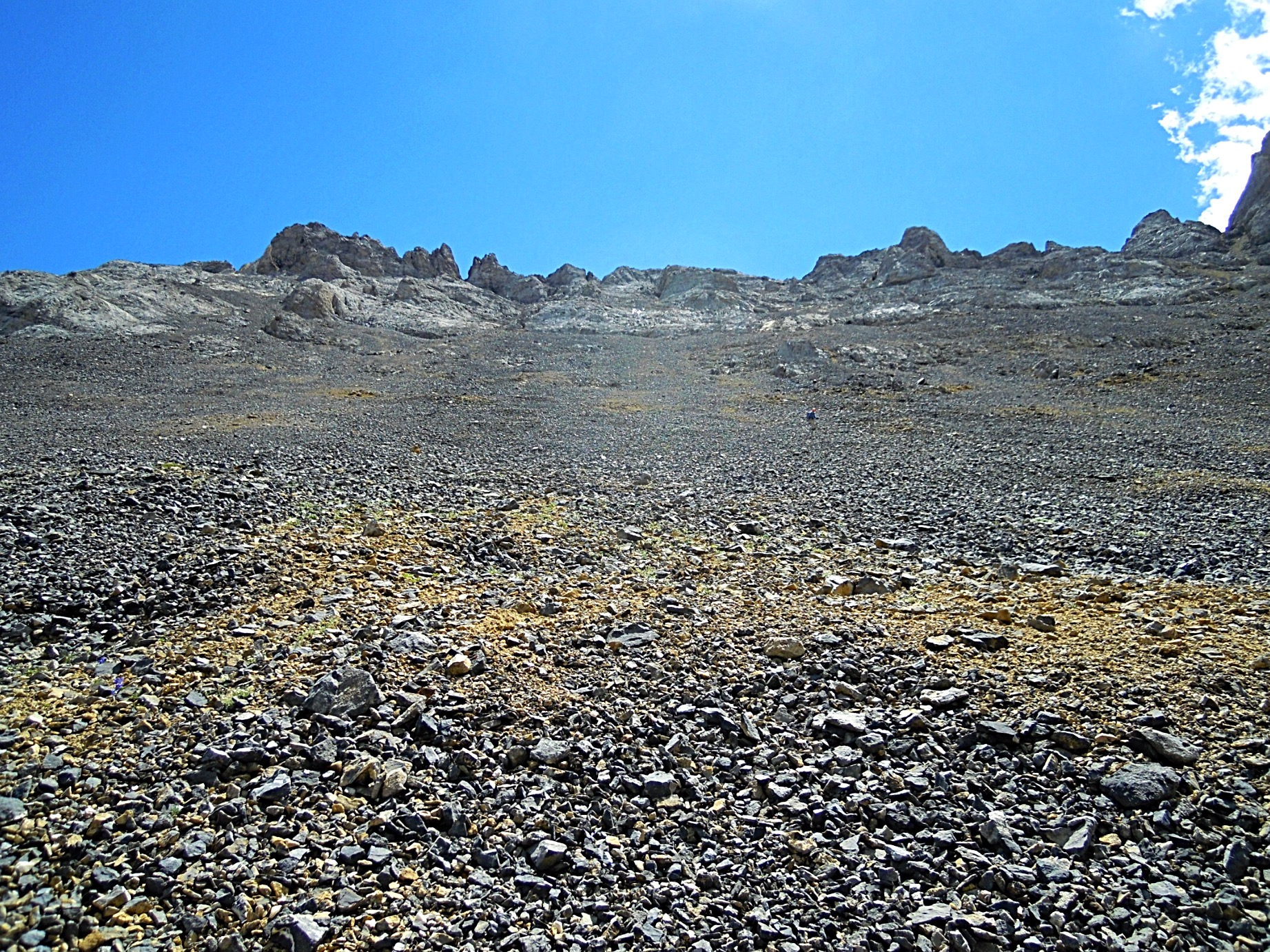 Partway up the scree slope. The summit is on the left. Judi Steciak Photo