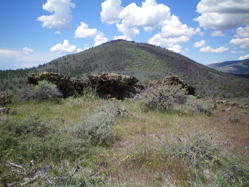 The summit boulders atop Half Cone with Big Cinder Butte in the background. Livingston Douglas Photo