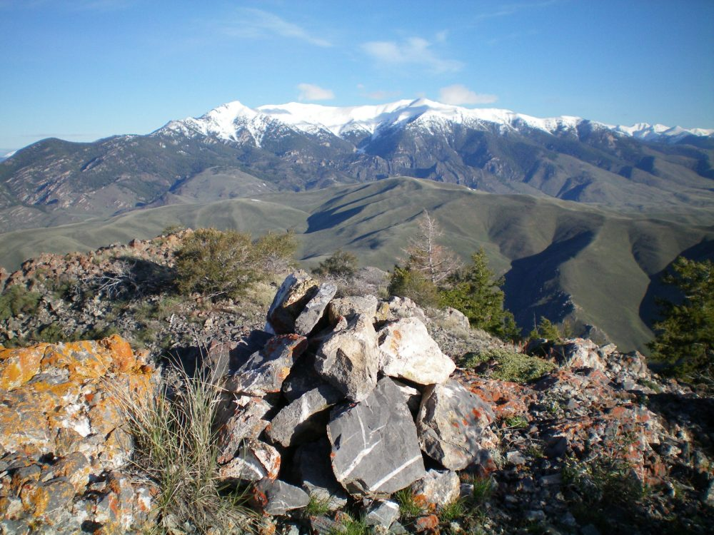 The summit cairn atop Peak 8170 with snow-covered King Mountain and North King Mountain in the background. Livingston Douglas Photo