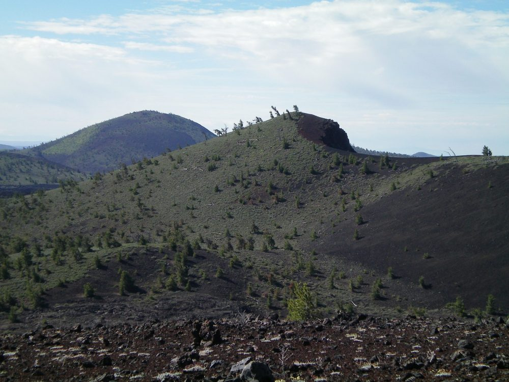 The North Side of Big Craters (right of center) as viewed from the summit of North Crater. Big Cinder Butte is in the distance (left of center). Livingston Douglas Photo