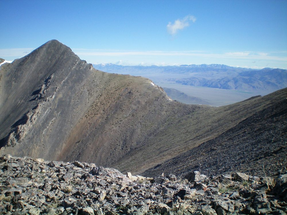 Tyler Peak (left of center) and its choppy Southeast Ridge (skyline), as viewed from the West Ridge of Mount Hoopes. The saddle is the low point between Tyler Peak and Mount Hoopes. Livingston Douglas Photo