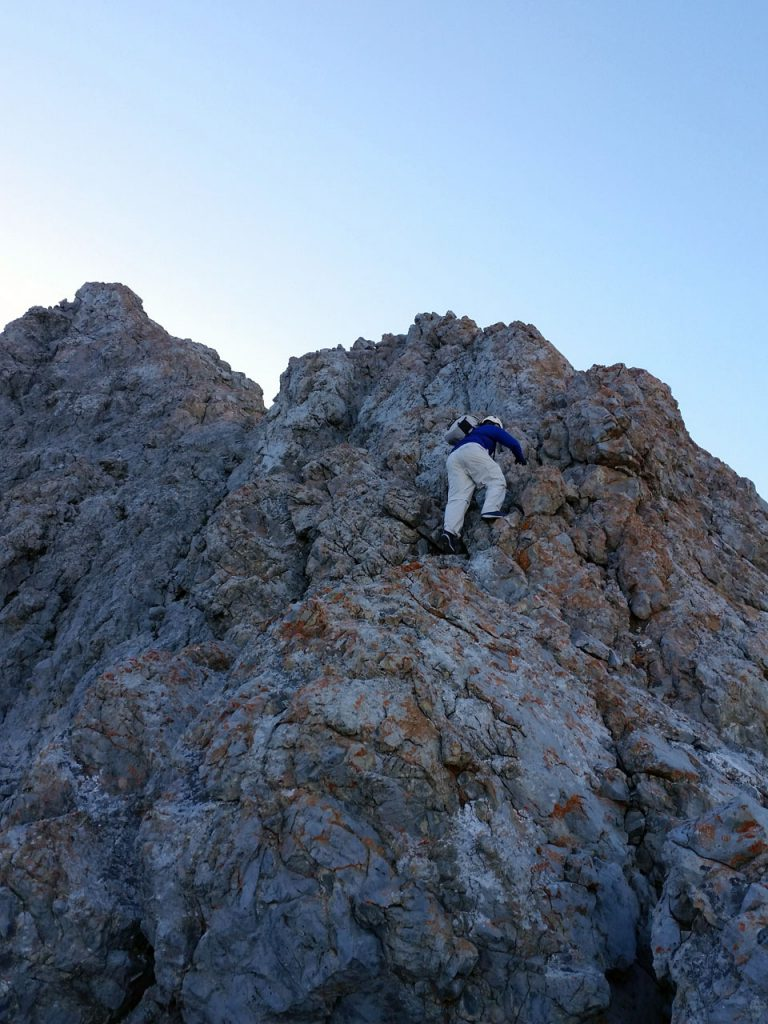 Kevin Hansen scrambling up the apron just above tree line. Thierry Legrain Photo
