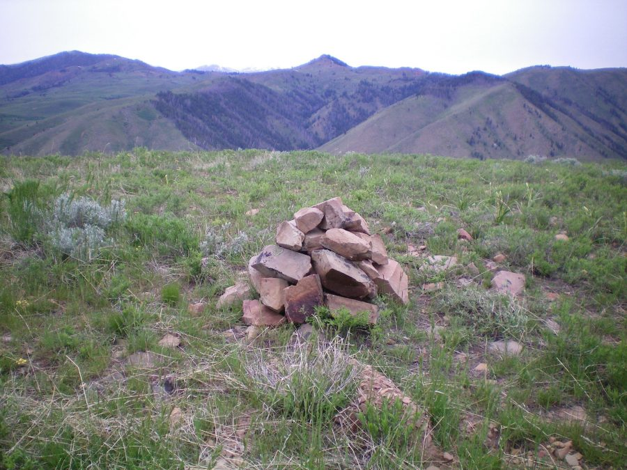 The summit cairn atop Peak 7422 with pyramidal-shaped Peak 8324 in the background (middle of photo). Livingston Douglas Photo