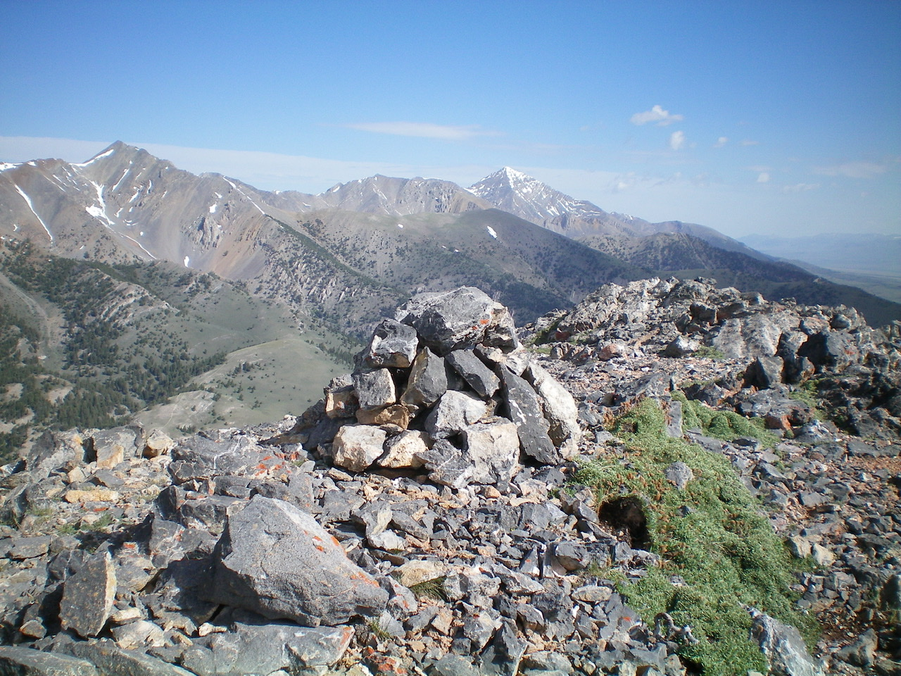 The summit cairn atop Marshalls Mount with snow-capped Diamond Peak just right of center in the distance. Livingston Douglas Photo