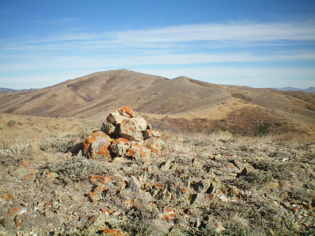 The summit cairn atop Peak 6844 with Quaking Aspen Mountain in the distance. Livingston Douglas Photo