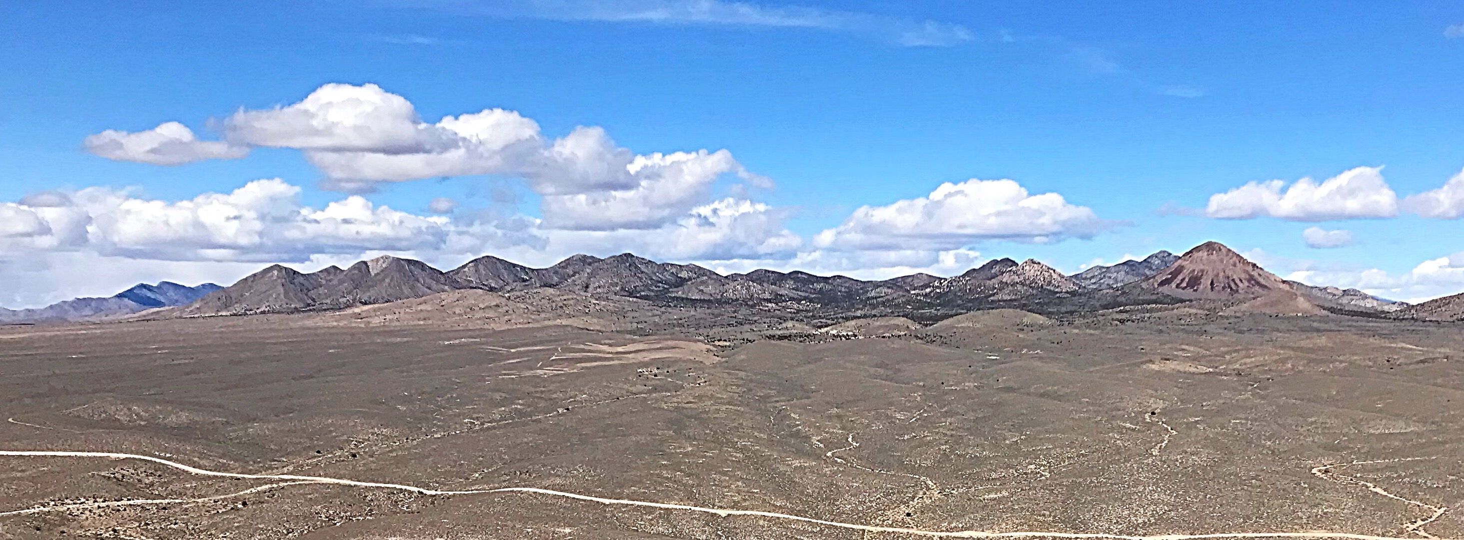 I was first attracted to the mountains between Lund and Hiko, Nevada when I spotted Burnt Peak. It is the cone shaped Summit on the right side of this ridge.