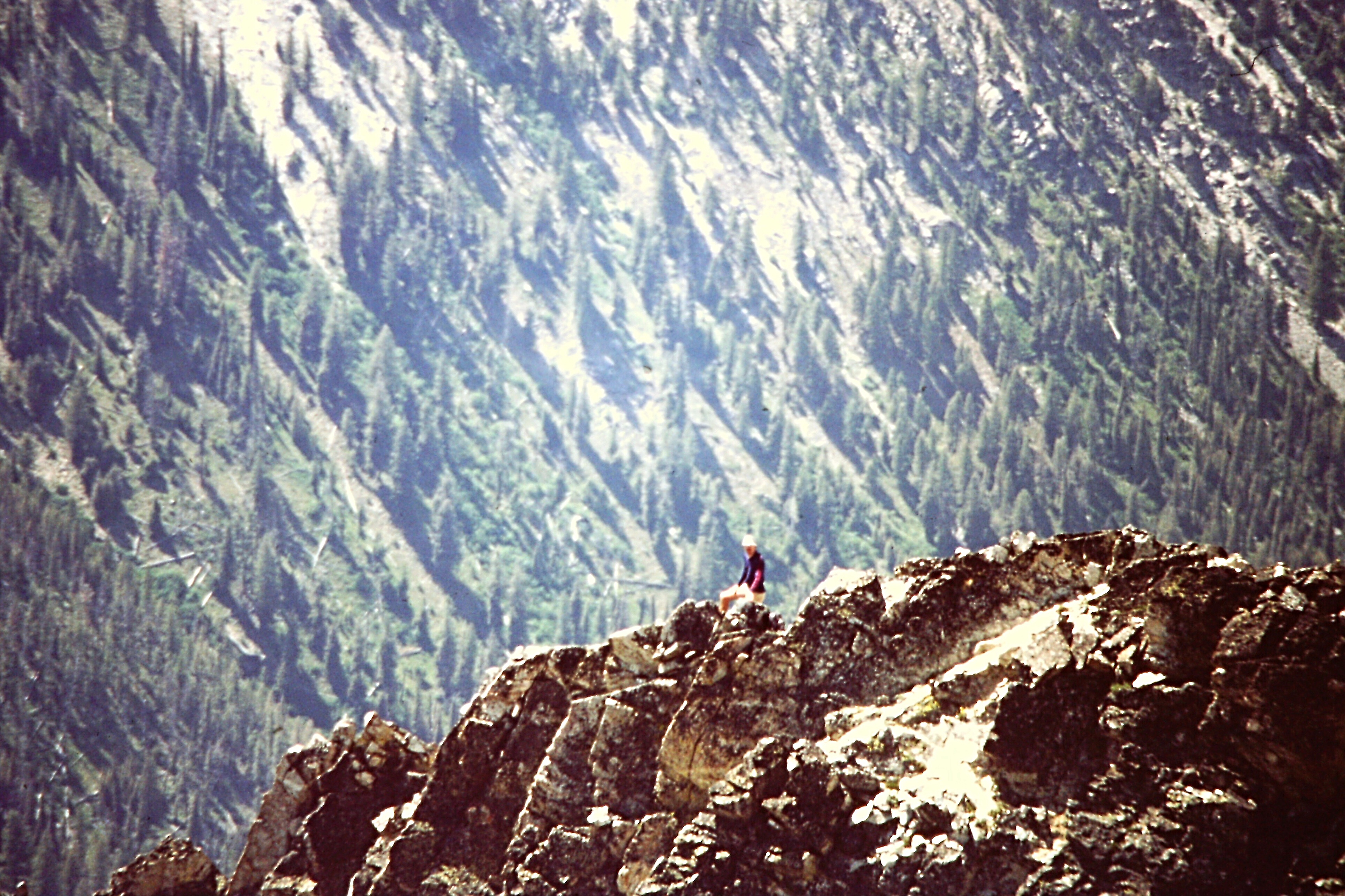Climbing the west ridge requires the careful crossing of exposed terrain. Steve Grantham Photo