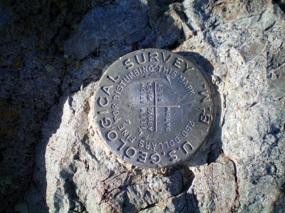 The USGS Benchmark on the summit of Pine Mountain. Livingston Douglas Photo