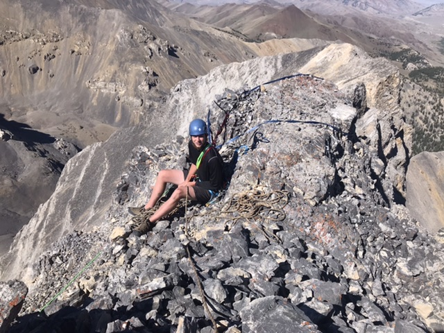 Daniel Todd belaying just below the summit. He was able to set up solid anchor on the block behind his back with the use of a lot of sling.