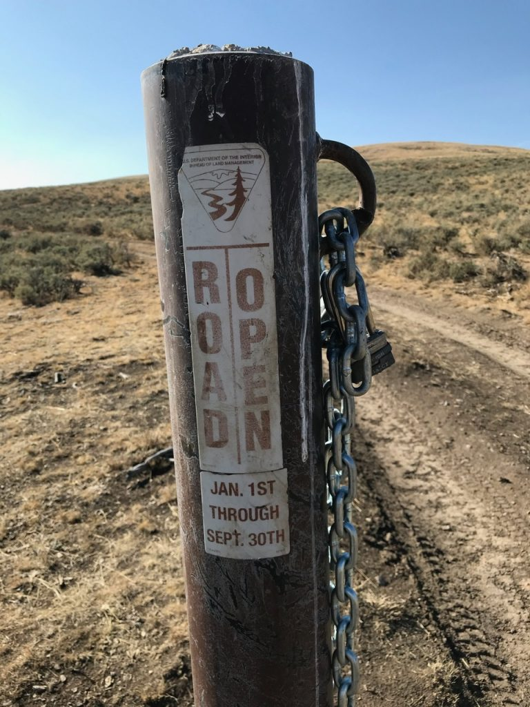"""The 4WD road """"sign and chain gate"""" off of Dry Gulch Road. Steve Mandella Photo"""