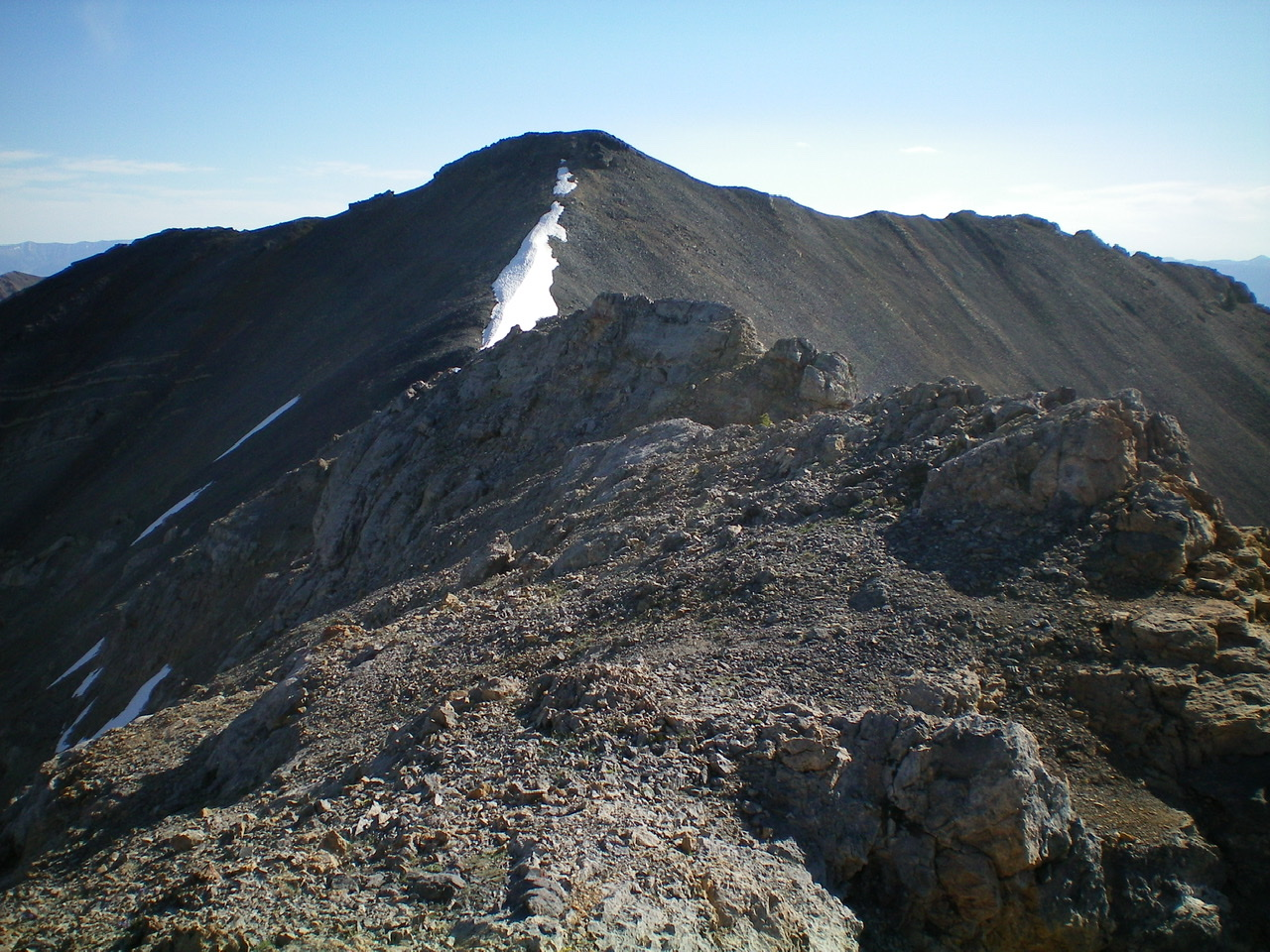 The rocky Southwest Summit area (foreground) with the true summit of Medusa in the background. Livingston Douglas Photo