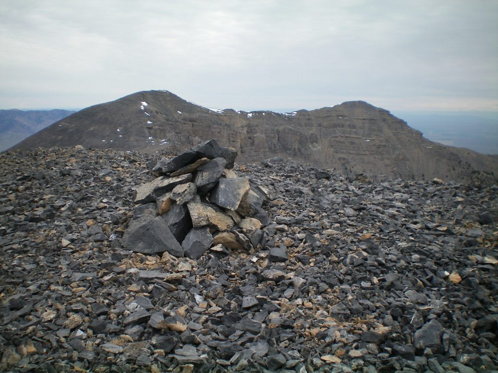 The small summit cairn atop Peak 10604 with Shril Peak (left) and Point 10601 (right) in the background. Livingston Douglas Photo