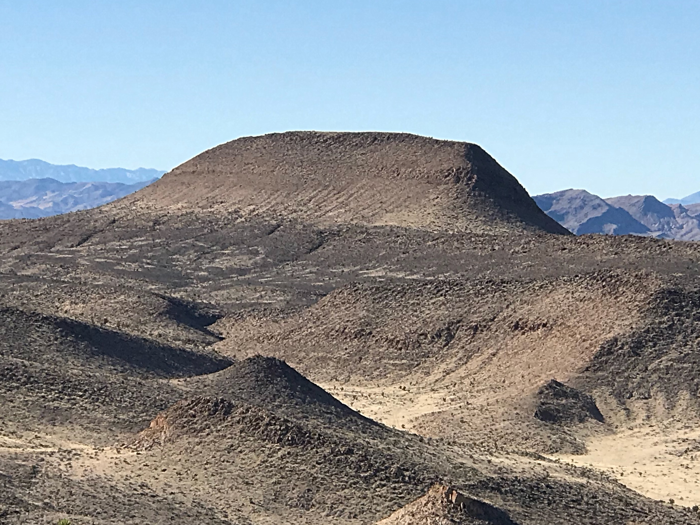 Alamo BM viewed from the northwest. This peak towers over Alamo, Nevada.