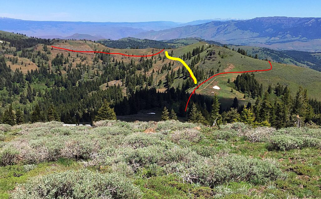 This photo is from the summit of Hitt Peak. It shows the ridge running north toward Sturgill Peak. The road, shown in red, traverses the east side of the ridge. I followed game trails on the west side of the ridge, shown in yellow. This route avoided climbing over the intermediate high point and is shorter than the road.