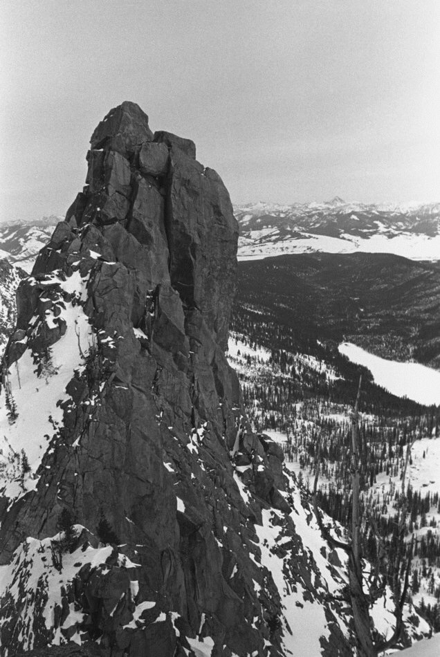 The Finger of Fate viewed from the buttress, with Hell Roaring Lake snowed over down below, looking east toward the Sawtooth Valley. Our cars are waaaay out there. Big bad Castle Peak on the horizon.