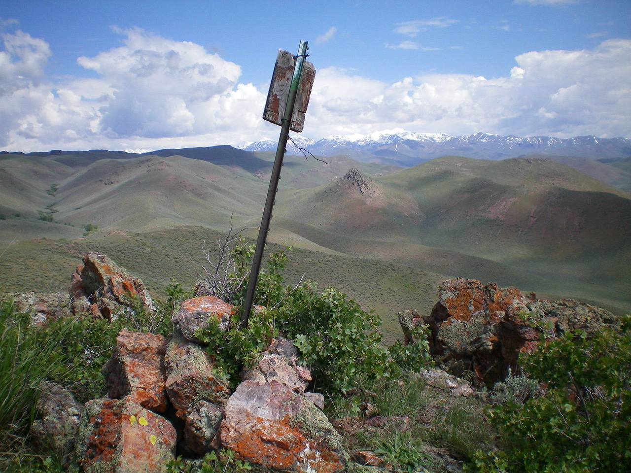 The summit cairn and survey marker atop Peak 6041. Livingston Douglas Photo