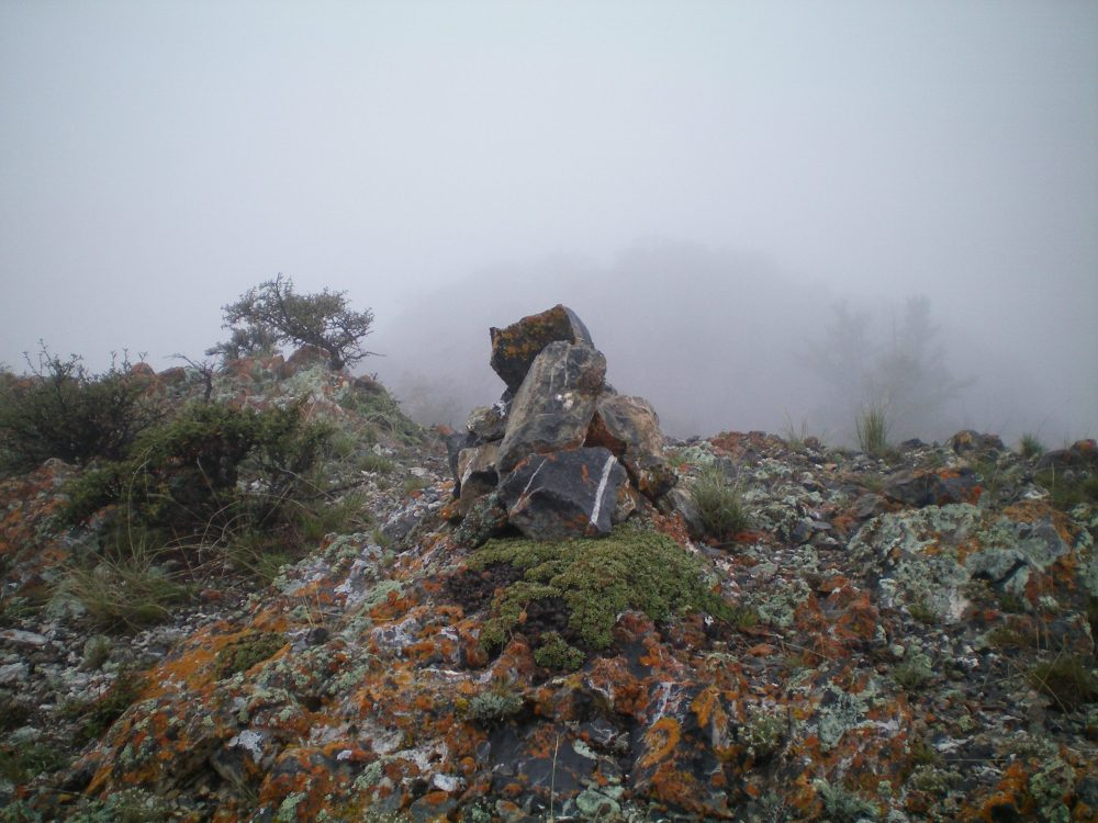 The newly-refurbished summit cairn atop Arco Hills HP on a cold, rainy morning in Eastern Idaho. Livingston Douglas Photo