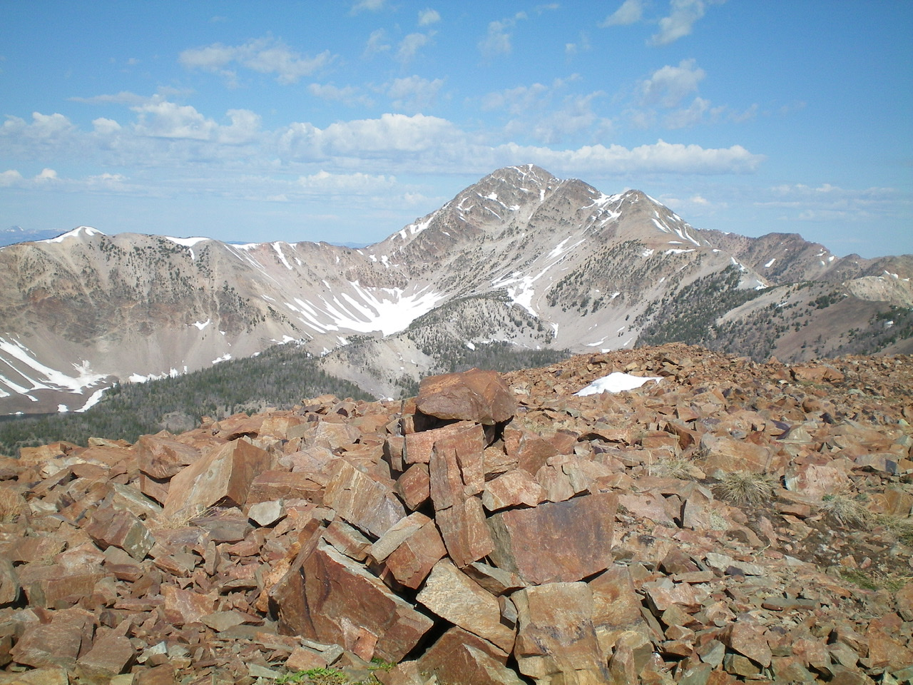 The shale-strewn summit of Peak 10263 with May Mountain in the background. Livingston Douglas Photo