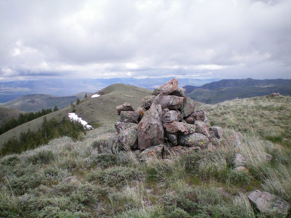 The summit cairn atop Peak 6910. The [lower] East Summit is in the background. Livingston Douglas Photo