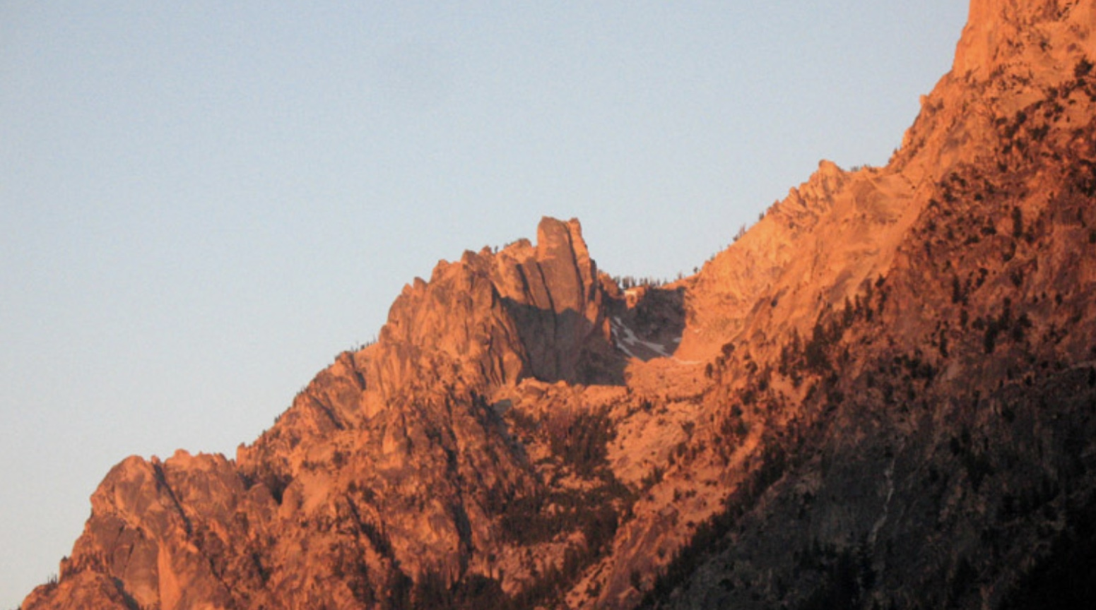 Early-morning alpenglow on the Grand Aiguille, at center of photo. Ray Brooks Photo