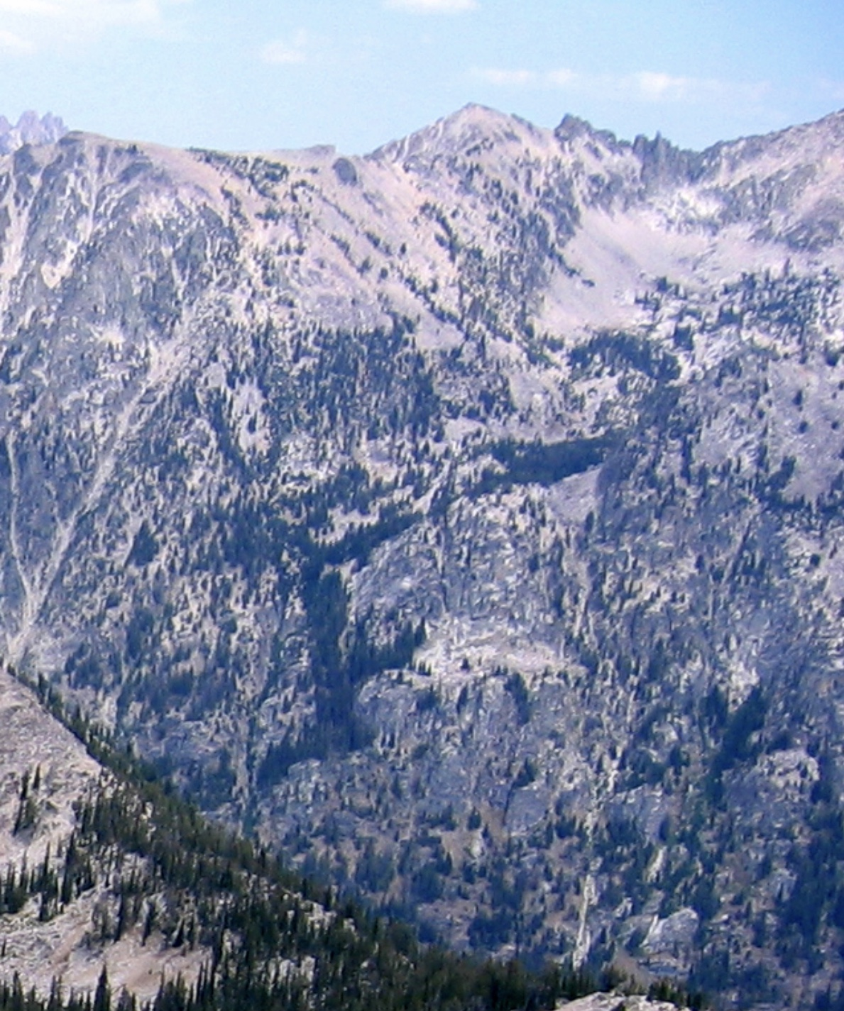 Reward Peak at top center, from near the North Raker.   Fred & Pete went 3,400 vertical feet up and down the appropriately named Drop Creek drainage, below Reward Peak. Ray Brooks Photo