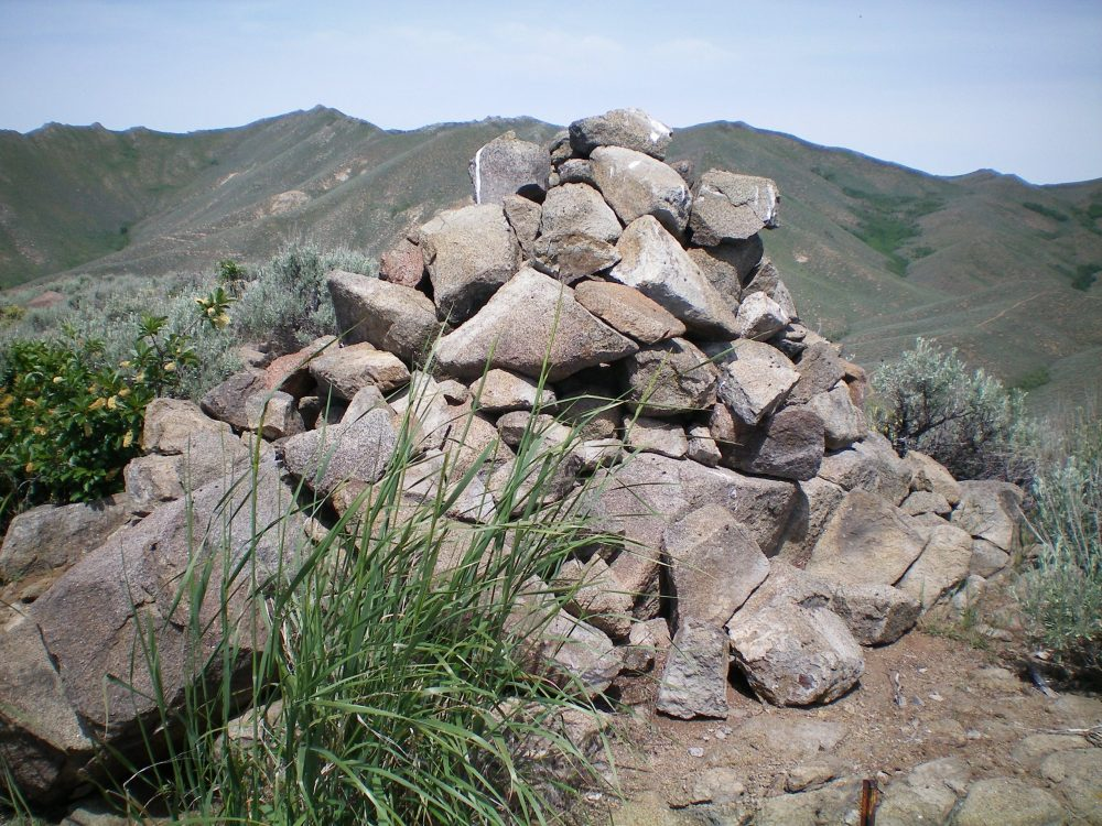 The massive cairn atop Rattler Butte with the ever-present sagebrush close by. Livingston Douglas Photo