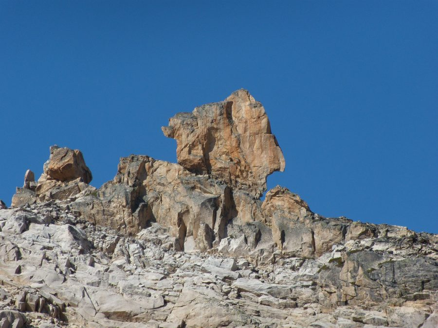 This photo shows the east side. But you climb the west side. I think you drop through a saddle on the left and drop down a bit, then scramble back up to the beginning of the route. The route goes up sort of the center of the face. Not a lot of pro, yet it's 5.9. John Platt Photo