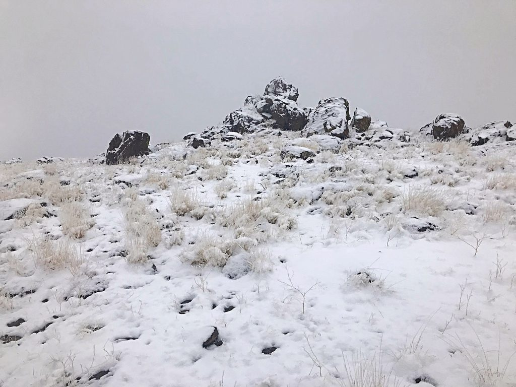 This outcrop is the highest point of Reynolds Peak. Circle around the north side where you will find a tall step that leads to the top. There is a summit register.