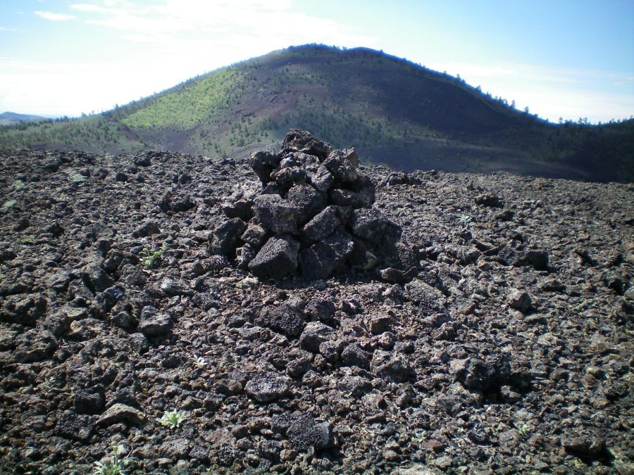 The summit cairn atop Broken Top with Big Cinder Butte in the background. Livingston Douglas Photo