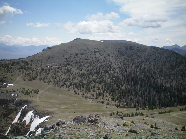 Trail Peak as viewed from the south end of the summit plateau of Windy Peak. The left skyline is the Northwest Ridge. Notice the plethora of old mining roads up here. Livingston Douglas Photo
