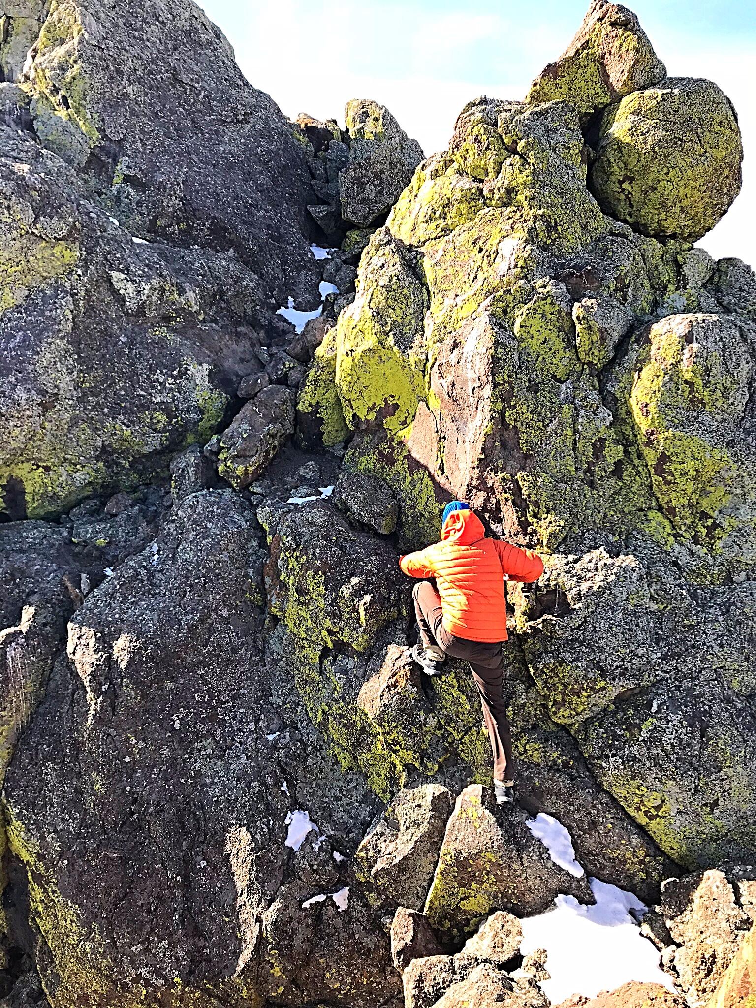 Pat McGrane climbing over the crux.