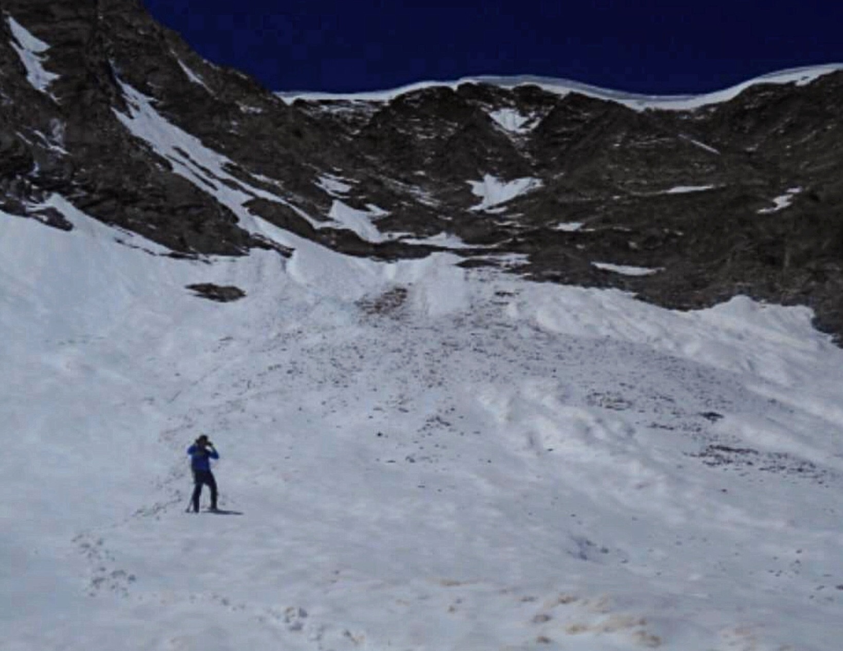 Taylor below the cornice on the Petros-Pahsimeroi Pyramid saddle after a quick descent. Pat McGrane Photo
