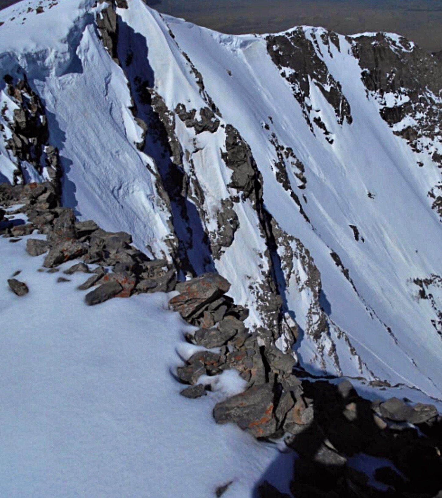 The North Face coming into the sunshine. Our tracks can be seen in the lower right. Pat McGrane Photo