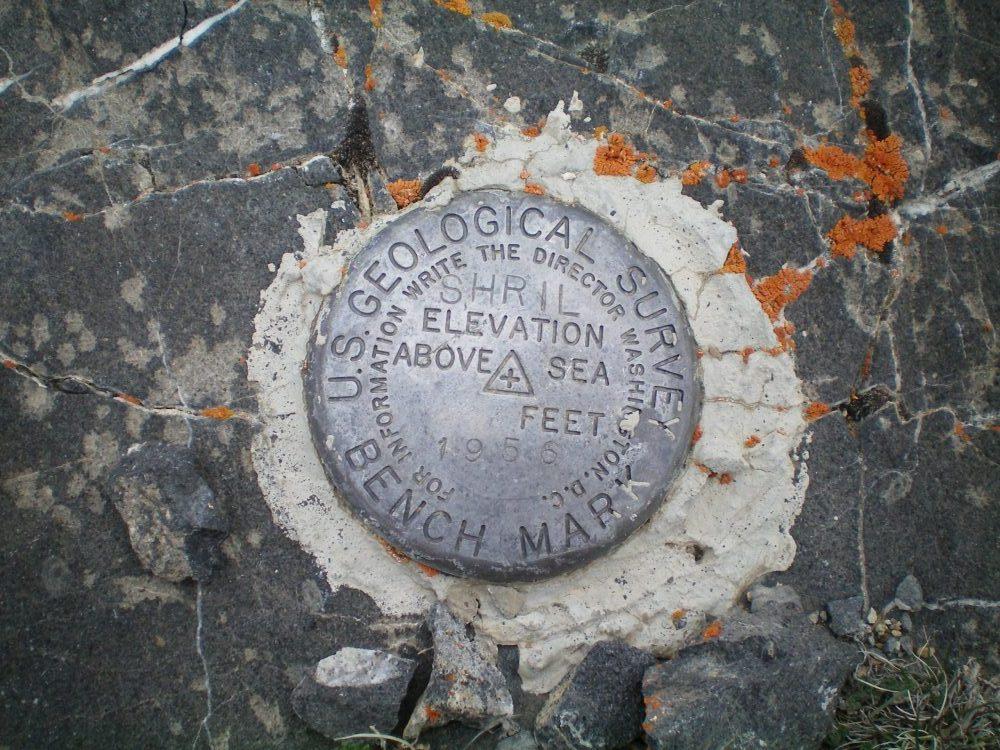 The summit Benchmark. Livingston Douglas Photo