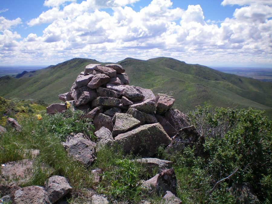 The summit cairn atop Peak 6025 looking south. Peak 6145 is the most distant hump right of center. The ridge traverse to get there is a tedious endeavor with lots of weaving and ups/downs. Livingston Douglas