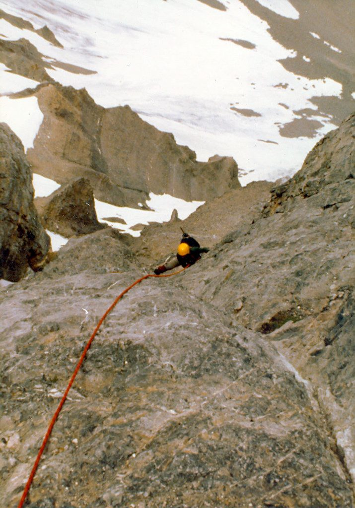 Mike on the rock band pitch between the two hanging snow fields. Photo - Curt Olson