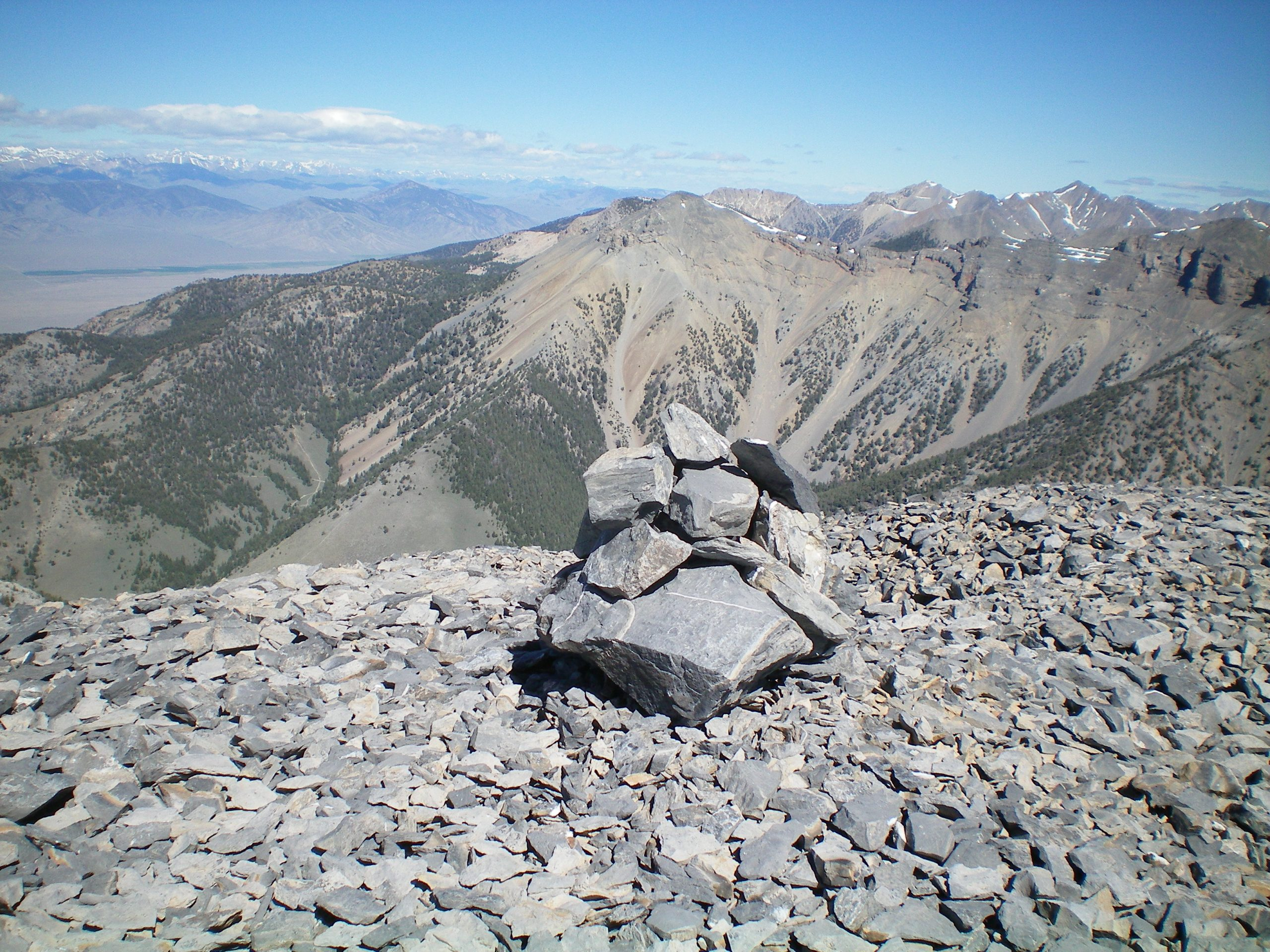 The newly-built summit cairn atop Tyler Peak with Peak 10604 in the background (dead-center). Livingston Douglas Photo