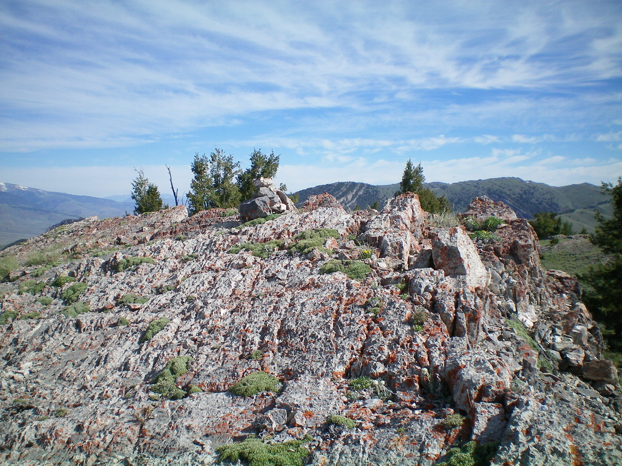 The rocky summit area of Peak 8603 with its small summit cairn. Livingston Douglas Photo