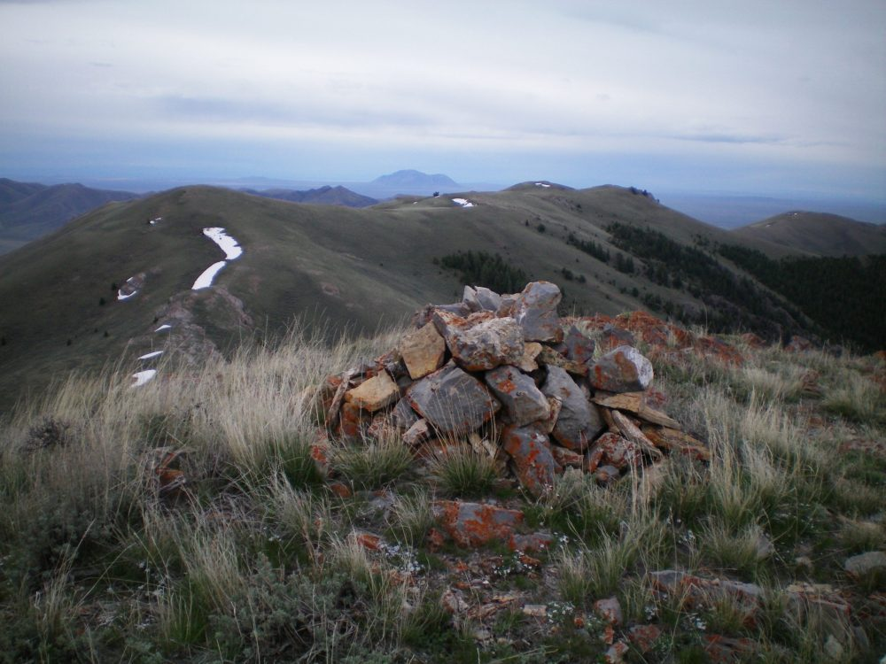 The southernmost summit cairn atop Peak 8150, looking south toward Peak 8082 in the distance and the connecting ridge. Livingston Douglas Photo