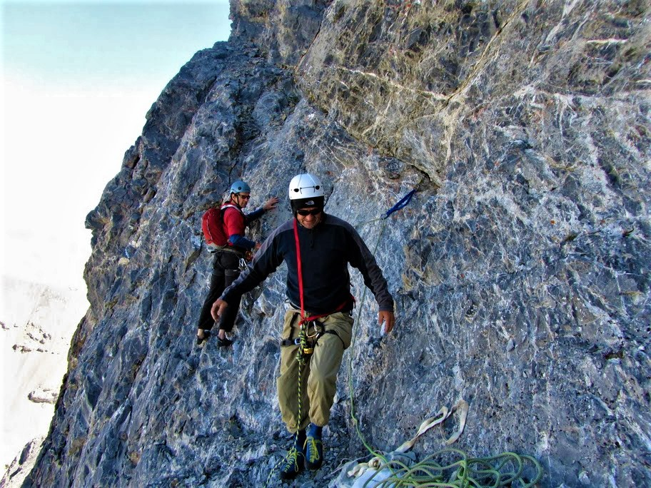 """Pat McGrane note—The start of the climb is characterized by a relatively crack free area of grey rock with white veins throughout. See attached photo """"Pat and John at the start..."""""""