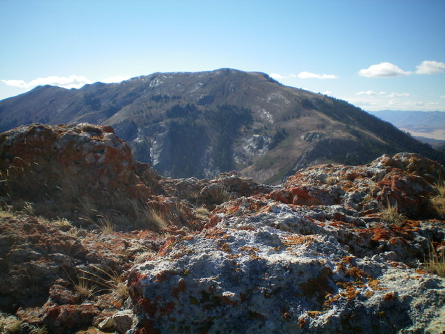 The summit rocks of Peak 8037 with Scout Mountain in the background. Livingston Douglas Photo