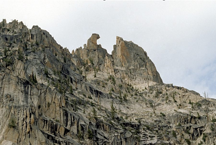 The South-East-face of Fishhook Spire, at top center.  Becky route follows line of weakness to notch, at right of hook, then goes behind the spire. Ray Brooks Photo