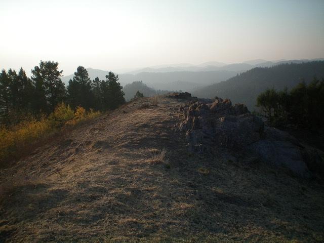 The rocky summit of Peak 7620 North, looking southeast on a smoke-hazy Sunday morning. Livingston Douglas Photo