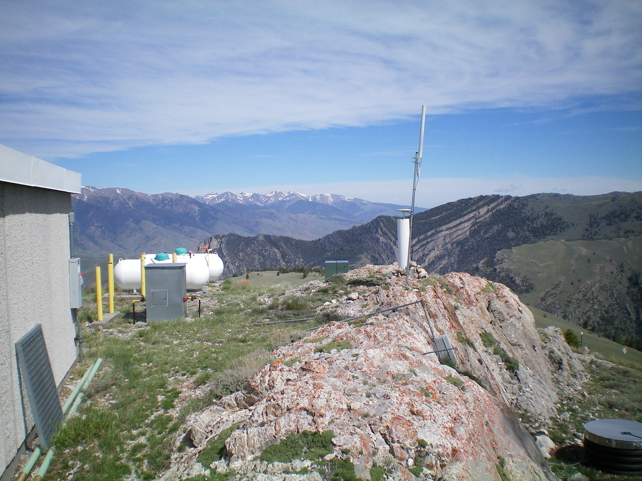 The massive summit block atop Howe Peak with the antenna installation planted firmly in it. Livingston Douglas Photo