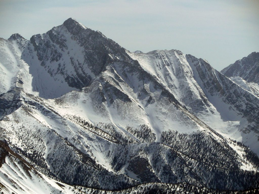 The northwest ridge rising from bottom right to upper left. Chicken out ridge is in the background. Mike climbed the left (east) spur while Vaughn Howard climbed the right (west), meeting at the Y. Both spurs rise up from Rock Creek and are very prominent when viewed from the right location. The east spur overlooks the NF where the west spur keeps COR ridge in view. John Platt Photo