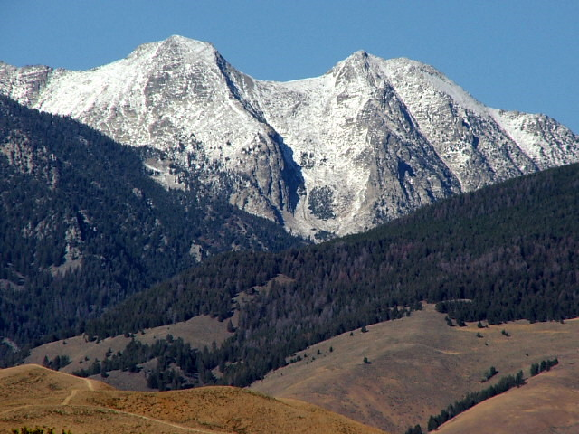 The Sacajawea Peaks clothed in the first snows of the season.  Photo taken September 24, 2006. Michael Darcy Photo