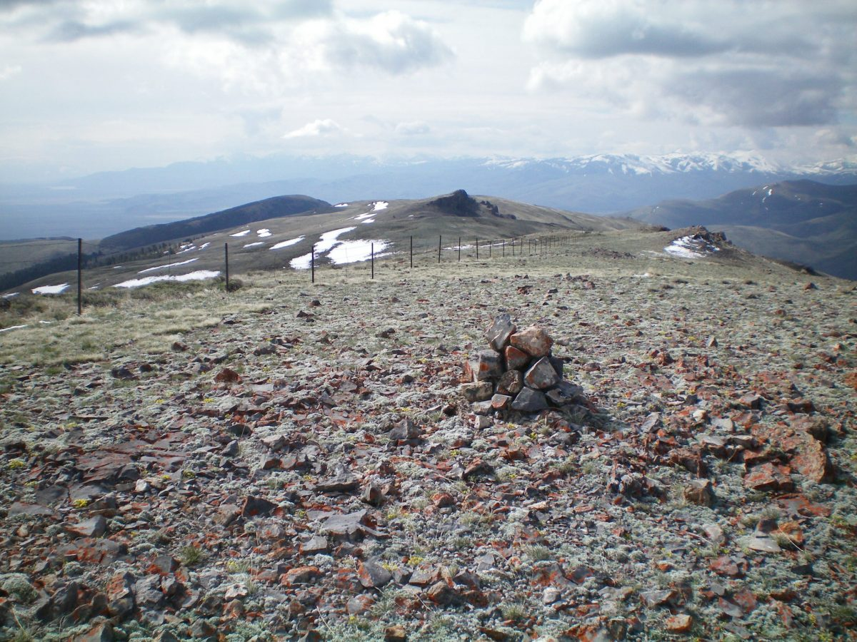 The newly-built summit cairn atop Peak 8923, looking down the long South Ridge. Rocky Point 8787 is visible in the dead center. Livingston Douglas Photo